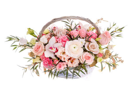 Bright buketny composition from fresh flowers, the white background