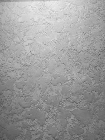Black textured wall in decorative plaster, background