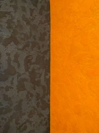 Orange with black textured wall in decorative plaster, background