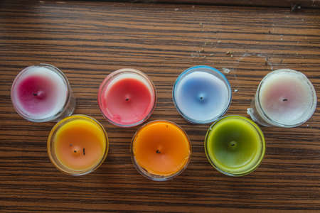 whiff: Fragrance Candles of various colors by blur background,Top view.