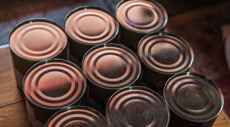 Canned condensed milk were sorted. Stock Photo