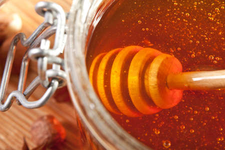 Close-up of dipper in a honey jar Stock Photo