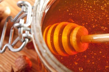 Close-up of dipper in a honey jar Stock Photo