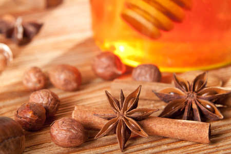 Anise stars in front of a honey jar