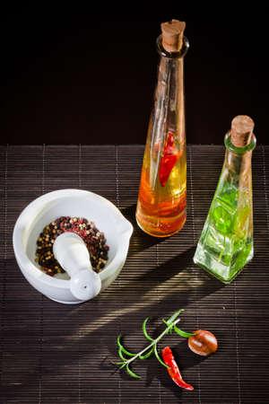 Multi colored pepper in a mortar Stock Photo