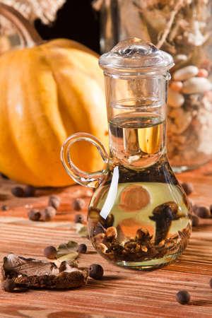 Bottle of cloves in oil Stock Photo