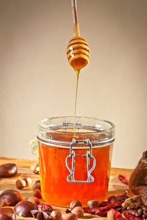 Honey dripping from honey spoon