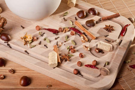 Nuts and spices on a wooden board Stock Photo