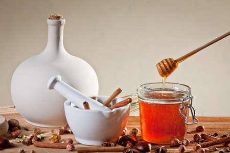 Dipper above honey jar
