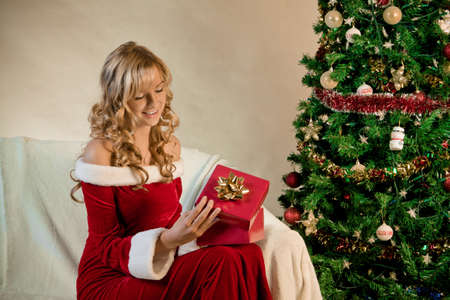 Portrait of a beautiful woman with a gift Stock Photo