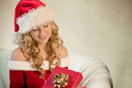 Portrait of a young woman in santa hat