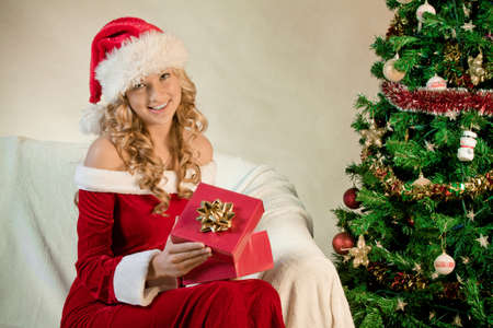 Portrait of a young woman with a Christmas gift Stock Photo