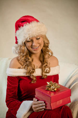 Portrait of a beautiful woman with a Christmas gift