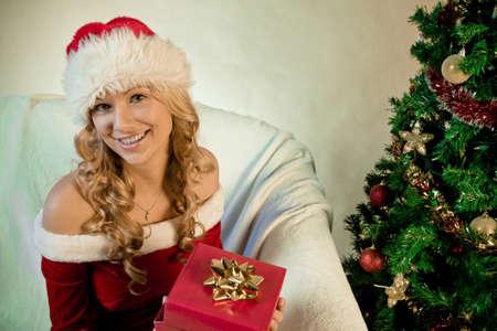 Young woman enjoying her Christmas gift Stock Photo