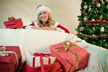 Beautiful woman surrounded by Christmas gifts