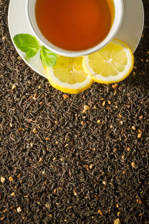 White cup on dried tea background