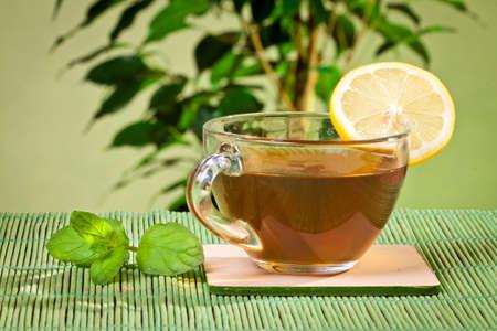 Slice of lemon on a cup of black tea