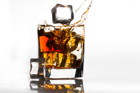 Ice cubes falling into a snifter Stock Photo - 13633153