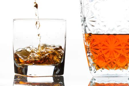 Pouring bourbon next to a decanter