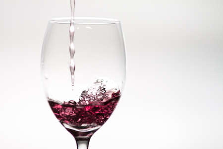 Pouring wine into a wineglass Stock Photo