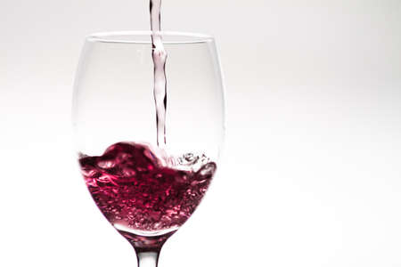 Filling up a wineglass