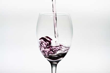 Splash of wine inside a wineglass