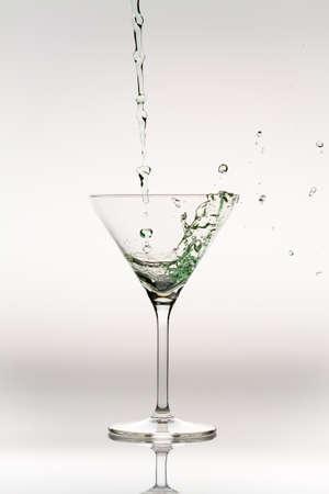 Splash of liquor inside a cocktail glass