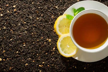 White cup of tea on dark background Stock Photo