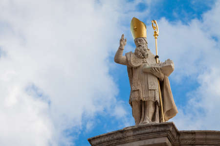 A statue of St  Blaise holding a model of Dubrovnik photo