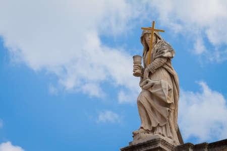 Religious figure  on top of St  Blaise church Stock Photo