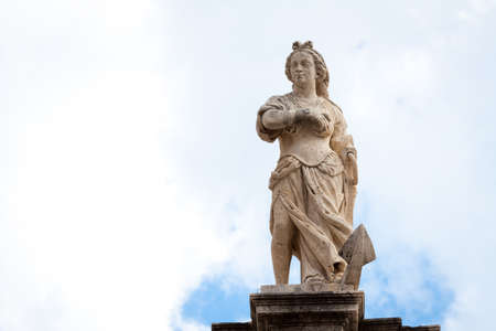 Woman rising above an anchor statue on top of St  Blaise church Stock Photo