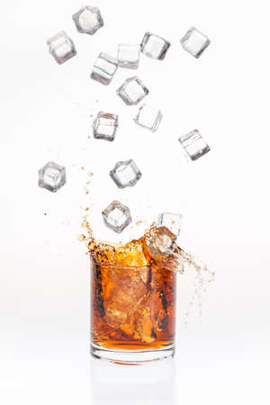 Ice cubes splashing bourbon photo