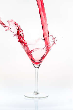 Blended drink splashing into cocktail glass Stock Photo
