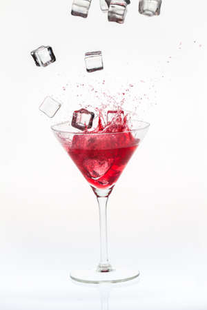 Ice cubes falling into a blended drink Stock Photo