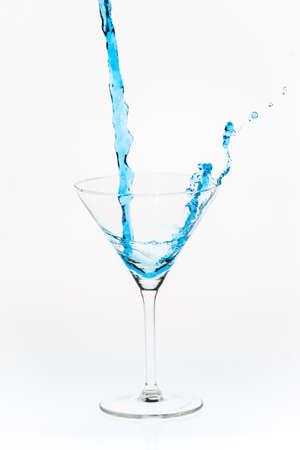 Blue blended drink splashed Stock Photo