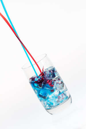 Blue and red stream mixing in a highball Stock Photo