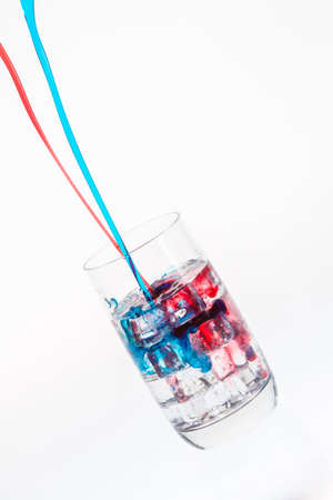Mixing a colorful drink on ice