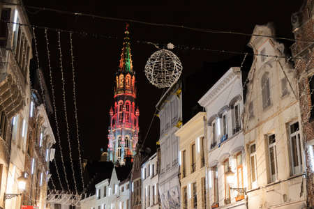 Illuminated town hall tower in the Grand Place, Brussels