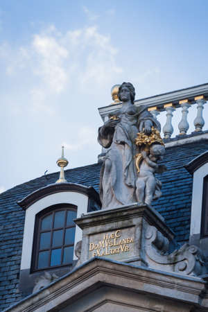Statue on a roof in the Grand Place, Brussels Stock Photo