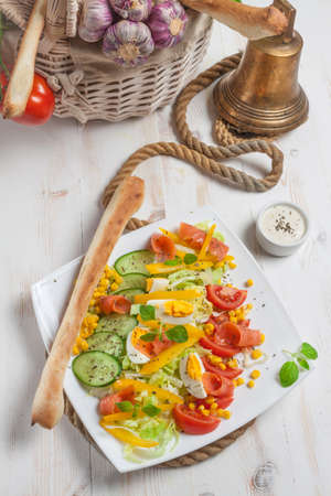 Fresh salad with breadstick