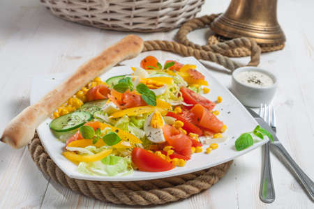 Fresh salad with breadstick close-up Stock Photo