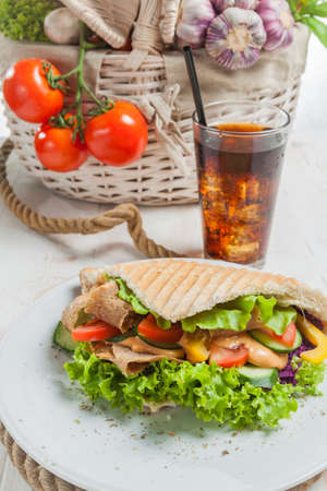 Kebab in grilled pita bread close-up Stock Photo