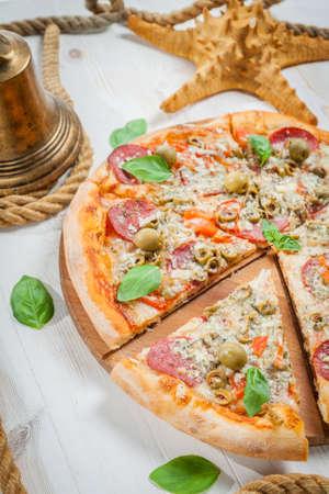 Pepperoni pizza next to starfish