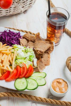 Kebab based meal on a plate