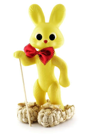 Yellow plastic bunny in bast shoes photo