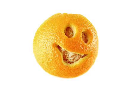 Smiling face carved on orange peel over white background