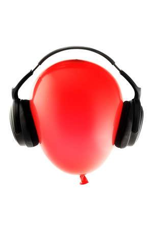 Red balloon with headphones Stock Photo