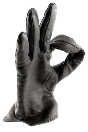Black leather glove showing an O.K. gesture photo