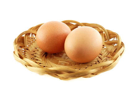 Two eggs in a wicker dish photo