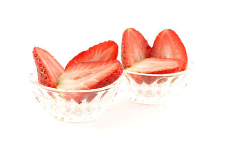 Strawberry halves in glass dishes photo